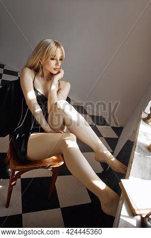 Retro Portrait Sexy Blonde Woman In Black Dress, Vintage Interior Woman Posing At Window. Sensual Ro