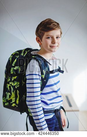 Beautiful Kid Boy With Schoolbag Rucksack Standing In Room In Early Morning. Happy Healthy Child On