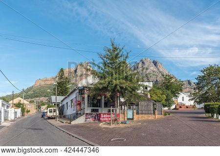 Pniel, South Africa - April 12, 2021: A Street Scene, With A Business, Vehicle And Houses, In Pniel