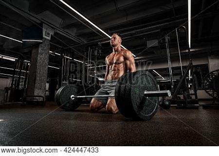 A Bodybuilder Is Going To Lift A Barbell, Work In A Gym With Large Weights, Training With A Sports E