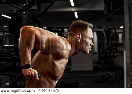 Pain During Exercise, Work With His Own Weight, The Athlete Does Exercises On The Uneven Bars Overco