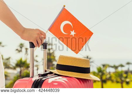 Woman With Pink Suitcase, Hat And Turkey Flag Standing On Passengers Ladder And Getting Out Of Airpl