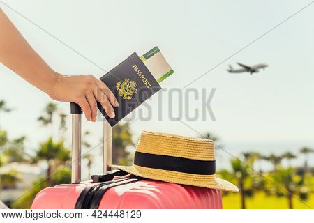 Woman With Pink Suitcase And Amerian Passport With Boarding Pass Standing On Passengers Ladder Of Ai