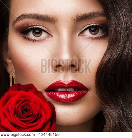 Beauty Woman Face Red Lipstick Portrait With Rose. Fashion Model Girl Red Lips Make Up. Luxury Skin