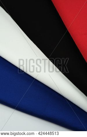 Background Of Different Colors Of Fabric. Material For Sewing.