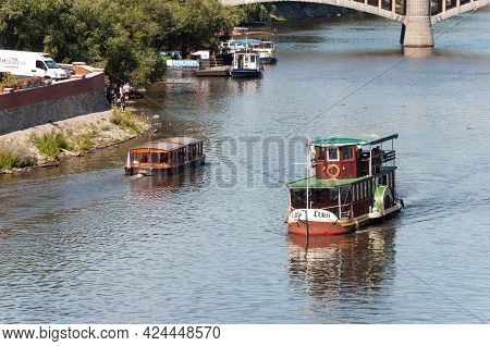 Prague, Czech Republic - July 23, 2019: Old Pleasure Boats With Tourists On Vltava River In Center O