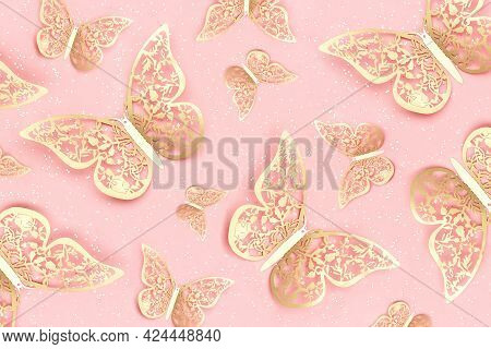 Festive Background Made With Gold Tracery Illuminating Butterflies And With Shiny Confetti On Pink.