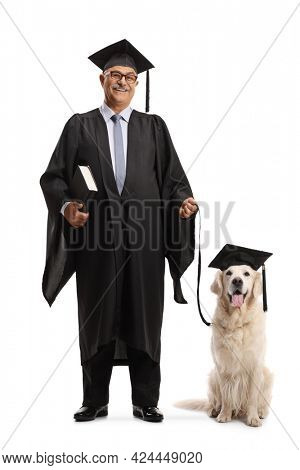Full length portrait of a mature man in a graduation gown with a retriever dog on a lead isolated on white background