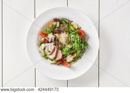 Caesar Salad With Vegetables, Egg, Croutons, Chicken And Parmesan Cheese