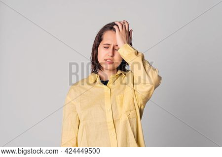 Shocked Beautiful Teen Girl In Casual Yellow Shirt, Look Puzzled And Amazed, Holding Hand On Head, S