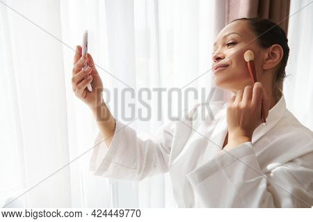 Beauty Portrait Of An Attractive Mixed Race Woman Standing In Front Of Sunlight By The Window And Lo