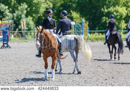 Group Of Horse Riders Waiting For Dressage Test