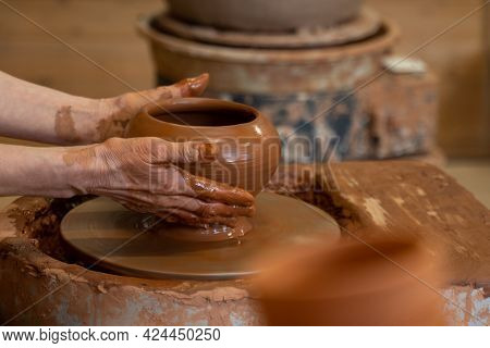 Hands Of An Elderly Potter Working With Clay On A Potters Wheel