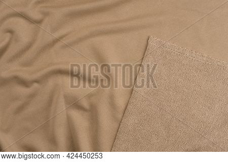 Background From Beige Monochrome Cotton Fabric. Close Up Texture