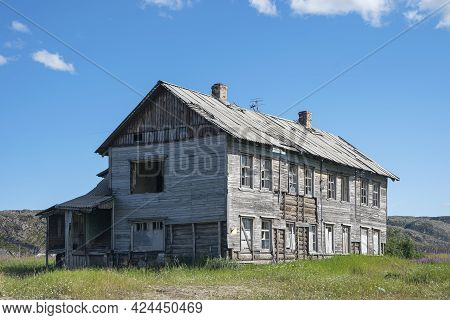 Teriberka, Russia - July 25, 2020: Old Destroyed Abandoned Wooden Building With The Broken Out Windo