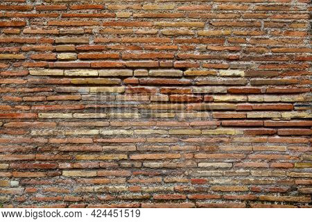 Ancient brickwork of flat roman bricks, Italy. May be used as background