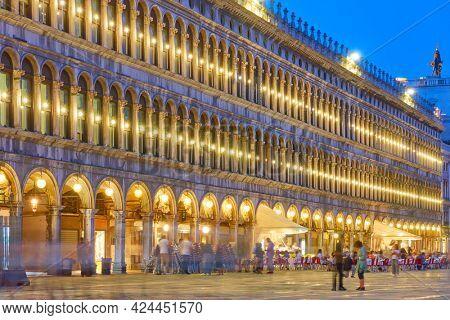 Venice at night. Illuminated building on Saint Mark Square (Piazza San Marco) at dusk, Italy