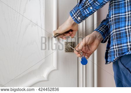 A Close Up Person Come Home And Open The Door With The Keys