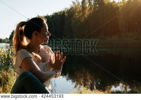 Yoga Meditation Outdoors. Portrait Of A Young Woman Practicing Yoga In Nature. Yogi Sitting With Clo