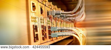 fiber optical cables connected to optic ports and network cables connected to ethernet ports.