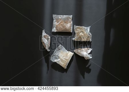 View From Above Of Several Rice And Other Porridge In Quick Cooking Plastic Bags Package