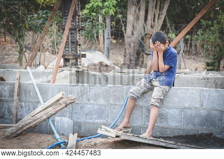 Portrait Of A Child In A Construction Site, Stop Child Labor Concept, Violence Children And Traffick