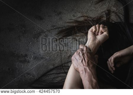 Close Up Man's Hand Holding A Woman Hand For Rape And Sexual Abuse Concept.