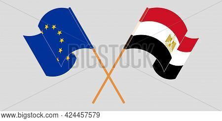 Crossed And Waving Flags Of Egypt And The Eu