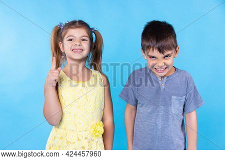 A Girl And A Boy. A Girl Says To A Boy He Must Learn A Lesson, A Boy Does Not Want. He Is Angry. A G