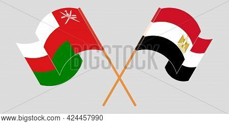 Crossed And Waving Flags Of Egypt And Oman