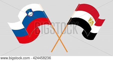 Crossed And Waving Flags Of Egypt And Slovenia