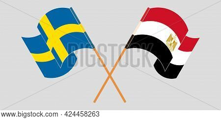 Crossed And Waving Flags Of Egypt And Sweden