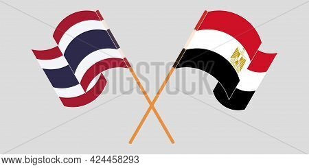 Crossed And Waving Flags Of Egypt And Thailand