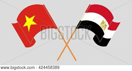 Crossed And Waving Flags Of Egypt And Vietnam