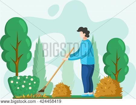 Young Man Doing Seasonal Garden Work, Remove Leaves With Rake, Works On Yard With Trees. Agricultura