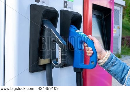 Charging Electric Car. Power Cable Pump Plug In Eco Green Energy Hybrid Vehicle On Future Charger St