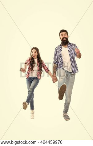 We Are On Our Way. Active Family Walk Holding Hands. Happy Child And Father Enjoy Studio Photo Shoot