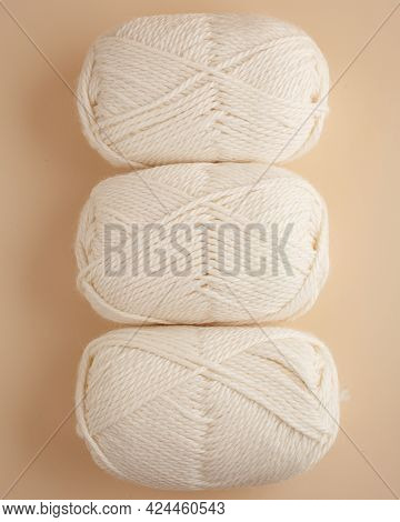 Three Skeins Of Yarn. Nice Photo For A Hobby, Vertical Orientation. Hobby Aesthetics.
