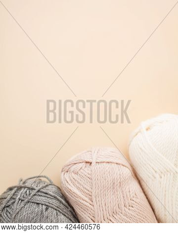 Three Skeins Of Yarn With Meth For Text. Nice Photo For A Hobby, Vertical Orientation. Hobby Aesthet