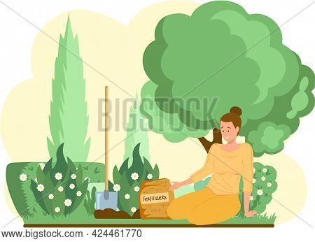 Gardening Concept. Spring Planting. Woman Gardener Takes Care Of Seedlings In Garden Uses Fertilizer