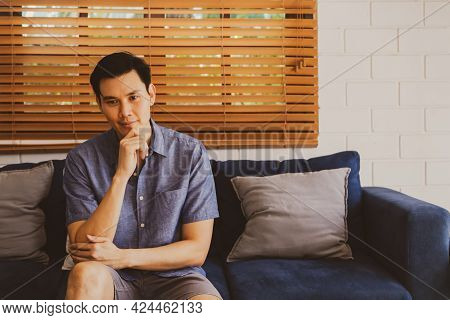 Portrait Handsome Asian Man Sits And Thinks About His Own Problem :  Personality Man Sitting On The