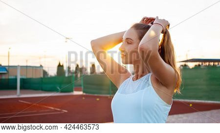 Portrait Of A Beautiful Young Woman At Sunset. Tennis Court, Athletic Body. Fitness, Weight Loss, At