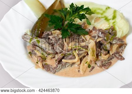 Beef Stew In Creamy Sauce With Mashed Potatoes And Pickles. Beef Stroganoff, Traditional Russian Dis