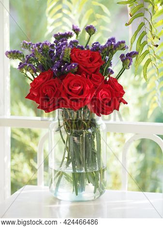 Red Rose And Dried Statice Flower Soft Pink, Violet Color In Clear Glass Vase Vintage Style, Concept