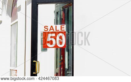 Sales Sign Fifty Percent Off Sign On A Door Front