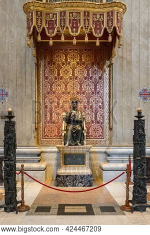 Vatican - June 1, 2020: Saint Peter enthroned statue in Saint Peter's Basilica, Rome, Italy.