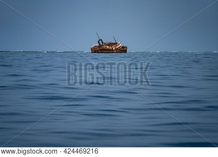 Sink Wrecked Ship Lie Down In Middle Of The Sea, Rusty And Old.