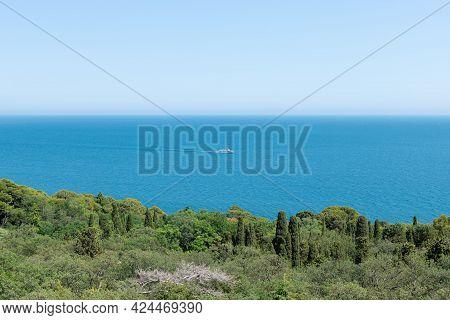 Beautiful Landscape With Calm Blue Sea And Blue Sky. Cruise Ship At Coast Of Sea. Luxury Cruise. Tra