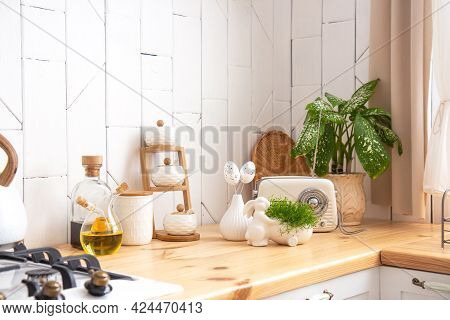 Kitchen Utensils And Wooden Dishes On A Wooden Shelf