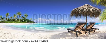 Chairs In Tropical Beach With Palm Trees On Coral Island